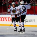 WASHINGTON, DC - JANUARY 01: Patrick Sharp #10 of the Chicago Blackhawks celebrates with Duncan Keith #2 after scoring in the first period of the 2015 NHL Winter Classic against the Washington Capitals at Nationals Park on January 1, 2015 in Washington, DC.  (Photo by Rob Carr/Getty Images)