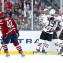 Jan 1, 2015; Washington, DC, USA; Chicago Blackhawks left wing Brandon Saad (20) celebrates with teammates Jonathan Toews (19) and Marian Hossa (81) after scoring a goal against the Washington Capitals in the second period during the 2015 Winter Classic hockey game at Nationals Park. Mandatory Credit: Geoff Burke-USA TODAY Sports