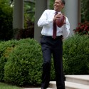 President Barack Obama tosses a football with Personal Aide Reggie Love in the Rose Garden of the White House, June 24, 2009. (Official White House Photo by Pete Souza)  This official White House photograph is being made available for publication by news organizations and/or for personal use printing by the subject(s) of the photograph. The photograph may not be manipulated in any way or used in materials, advertisements, products, or promotions that in any way suggest approval or endorsement of the President, the First Family, or the White House.