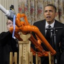Jody Hudy demonstrates marshmallow cannon with President Barack Obama