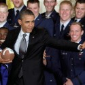 WASHINGTON, DC - APRIL 23:  U.S. President Barack Obama strikes a pose like the figure on the Heisman Trophy while presenting the U.S. Air Force Academy football team seniors with the Commander-In-Chief's Trophy April 23, 2012 in Washington, DC. The Air Force beat the Army and Navy in 2011 to claim the trophy for the 18th time.  (Photo by Chip Somodevilla/Getty Images)