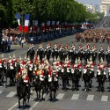 PARIS, FRANCE ? JULY 14: In this handout from the British Army, the Household Cavalry Mounted Regiment ride down the Champs Elysees at the start of the annual Bastille Day Parade July 14, 2004 in Paris, France. The Grenadier Guards were guests of the French Government to celebrate the 100th anniversary of the Entente Cordiale, a treaty of friendship signed in 1904. (Photo by Mike Harvey/British Army via Getty Images)