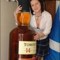 Kayleigh Rawsthorne (20) with the five foot bottle of 14-year-old Tomintoul whisky to be unveiled at the Clockhouse Restaurant in the Highland village.