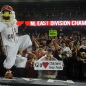 Oct 01, 2012; Washington, DC, USA; Washington Nationals mascot Screech and fans celebrate after clinching the National League East title at Nationals Park. Mandatory Credit: Brad Mills-US PRESSWIRE