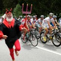 A fan dressed up as a devil runs ahead of the pack during the sixth stage of the Giro d'Italia, Tour of Italy cycling race, from Bressanone to Mayrhofen, Austria, Thursday, May 14, 2009. (AP Photo/Alessandro Trovati)