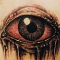 thumbs big eye halloween tattoo