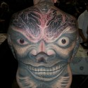 big-grinning-face-halloween-tattoo