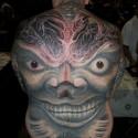 thumbs big grinning face halloween tattoo