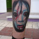 thumbs creepy girl halloween tattoo