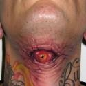 thumbs neck eye halloween tattoo