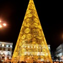A giant Christmas tree illuminates the Puerta del Sol in the centre of Madrid on December 9, 2013.  AFP PHOTO/ GERARD JULIEN        (Photo credit should read GERARD JULIEN/AFP/Getty Images)
