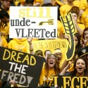 "Fans hold a sign in the final moments of Wichita State's NCAA college basketball game against Indiana State that says ""Still unde-VLEETed,"" referring to sophomore point guard Fred VanVleet, on Saturday, Jan. 18, 2014 in Wichita, Kan. Wichita State won 68-48. (AP Photo/The Wichita Eagle, Jaime Green) LOCAL TV OUT; MAGAZINES OUT; LOCAL RADIO OUT; LOCAL INTERNET OUT"