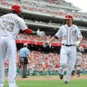 May 27, 2013; Washington, DC, USA; Washington Nationals first baseman Adam LaRoche (25) is congratulated by Roger Bernadina (33) during the second inning against the Baltimore Orioles at Nationals Park. Mandatory Credit: Brad Mills-USA TODAY Sports