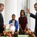President Obama, with daughters Sasha and Malia, at last year's turkey pardoning ceremony.