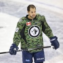 Mar 8, 2014; Winnipeg, Manitoba, CAN; Winnipeg Jets forward Devin Setoguchi (40) wears the camouflage jersey in support of the Canadian military prior to the game against the Ottawa Senators at MTS Centre. Mandatory Credit: Bruce Fedyck-USA TODAY Sports