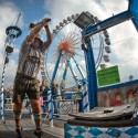 "MUNICH, GERMANY - OCTOBER 1:  A bavarian visitor in a traditional ""Lederhosen""  participates in a  funfair attraction called ""Hau den Lukas"" at the Oktoberfest 2013 beer festival at Theresienwiese on October 1, 2013 in Munich, Germany. At the funfair attraction ""Hau den Lukas"" you have three tries to hit the target with a hammer so hard that a bell at the top rings. The Munich Oktoberfest, which this year will run from September 21 through October 6, is the world's largest beer fest and draws millions of visitors. (Photo by Joerg Koch/Getty Images)"