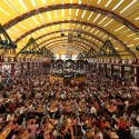 """People enjoy a sunny day at the 180th Bavarian """"Oktoberfest"""" beer festival in Munich, southern Germany, Wednesday, Oct. 2, 2013. The world's largest beer festival, to be held from Sept. 21 to Oct. 6, 2013 will attract more than six million guests from around the world. (AP Photo/Matthias Schrader)"""