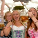 Girls celebrate during the opening of the Oktoberfest beer festival at the Theresienwiese in Munich, southern Germany, on September 21, 2013. The world's biggest beer festival Oktoberfest will run until October 6, 2013.  AFP PHOTO / CHRISTOF STACHE