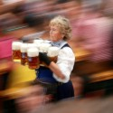 "A waitress carries beer mugs during the opening ceremony in the ""Hofbraeuzelt' beer tent of the 180th Bavarian ""Oktoberfest"" beer festival in Munich, southern Germany, Saturday, Sept. 21, 2013. The world's largest beer festival, to be held from Sept. 21 to Oct. 6, 2013 will attract more than six million guests from around the world. (AP Photo/Matthias Schrader)"