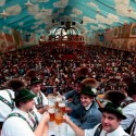 Visitors clink beer glasses in the XX tent at the Oktoberfest 2013 beer festival at Theresienwiese on September 22, 2013 in Munich, Germany. The Munich Oktoberfest, which this year will run from September 21 through October 6, is the world's largest beer fest and draws millions of visitors.