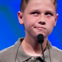 "Nathan Dugan, of Canton, Ohio, spells his word ""cantankerous"" during the National Spelling Bee, Wednesday, May 30, 2012, in Oxon Hill, Md.  (AP Photo/Evan Vucci)"