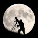 BRIGHTON, UNITED KINGDOM - SEPTEMBER 27:  An astronomer stargazes ahead of tonight's supermoon on September 27, 2015 in Brighton, England. Tonight's supermoon, so called because it is the closest full moon to the Earth this year, is particularly rare as it coincides with a lunar eclipse, a combination that has not happened since 1982 and won't happen again until 2033.  (Photo by Jordan Mansfield/Getty Images)