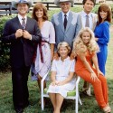 """Image #: 865453    The cast members from the television series """"Dallas"""" (standing L-R) Larry Hagman (as John Ross 'J.R.' Ewing, Jr.),  Linda Gray (as Sue Ellen Ewing), Jim Davis (as John Ross 'Jock' Ewing), Patrick Duffy (as Bobby Ewing), Victoria Principal (as Pamela Barnes Ewing), (center, seated) Barbara Bel Geddes (as Eleanor Southworth 'Miss Ellie' Ewing), and Charlene Tilton (as Lucy Ewing) pose for a picture on the property of the Southfork ranch in 1979.    CBS /Landov"""