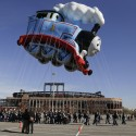 Handlers steer Thomas the Tank Engine balloon through the parking lot at CitiField, Saturday, Nov. 8, 2014, in New York. The balloon was taken for a practice run along with five other new character balloons in preparation for the 88th Annual Macy's Thanksgiving Day Parade. Thomas the Tank Engine will be the parade's largest balloon by helium volume and the one which contains the most balloon fabric ever used on one character. (AP Photo/Julie Jacobson)