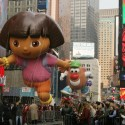 NEW YORK - NOVEMBER 22:  The Dora the Explorer and Mr. Potato Head balloons float at Times Square during the 81st annual Macy's Thanksgiving Day Parade on November 22, 2007, in New York City.  (Photo by Hiroko Masuike/Getty Images)